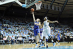 26 February 2012: Duke's Tricia Liston (32) takes a layup past North Carolina's Candace Wood (4). The Duke University Blue Devils defeated the University of North Carolina Tar Heels 69-63 at Carmichael Arena in Chapel Hill, North Carolina in an NCAA Division I Women's basketball game.