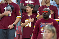 Landover, MD - August 24, 2018: Washington Redskins fan during the national anthem before preseason game between the Denver Broncos and Washington Redskins at FedEx Field in Landover, MD. The Broncos defeat the Redskins 29-17. (Photo by Phillip Peters/Media Images International)