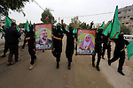 Members of Hamas movement hold the movement's flag as they take part in a rally ahead of the 27th anniversary of Hamas founding, in Shijaiyah in the east of Gaza city December 12, 2014. Photo by Mohammed Asad