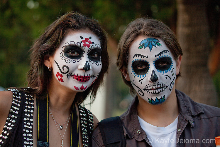 A couple with calavera face paint at the Dia de Los Muertos celebration at Hollywood Forever Cemetery in Hollywood, CA