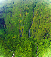 Several long waterfalls pour down the lush inaccessible mountains in the Kohala area of the Big Island of Hawaii