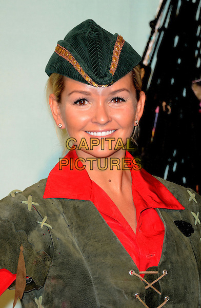 Jennifer Ellison .At a pantomime photocall for Peter Pan at the Churchill Theatre, Bromley, Kent, England..October 30th 2012.panto costume headshot portrait shirt green hat red  .CAP/WIZ.© Wizard/Capital Pictures.