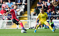 Lincoln City's Michael O'Connor vies for possession with Fleetwood Town's Kyle Dempsey<br /> <br /> Photographer Andrew Vaughan/CameraSport<br /> <br /> The EFL Sky Bet League One - Lincoln City v Fleetwood Town - Saturday 31st August 2019 - Sincil Bank - Lincoln<br /> <br /> World Copyright © 2019 CameraSport. All rights reserved. 43 Linden Ave. Countesthorpe. Leicester. England. LE8 5PG - Tel: +44 (0) 116 277 4147 - admin@camerasport.com - www.camerasport.com