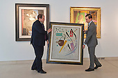 Pictured: Christie's Specialists are handling the painting Schwarze Spitzen 1937 by Kandinsky. Estimated to fetch $4-6 million. <br /> <br /> Christie's London unveils touring highlights from the New York &quot;Impressionist &amp; Modern Art Evening Sale&quot; which are on free public view from 28 March to 1 April, ahead of the auction in New York on 6 May 2014.