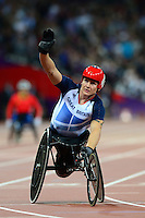 PICTURE BY ALEX BROADWAY /SWPIX.COM - 2012 London Paralympic Games - Day Six - Athletics, Olympic Stadium, Olympic Park, London, England - 04/09/12 - David Weir of Great Britain celebrates victory in the Men's 1500m T54 Final.