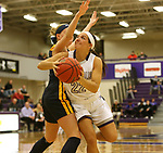 SIOUX FALLS, SD - DECEMBER 7: Mariah Szymanski #22 from the University of Sioux Falls drives against Lexi Lee #14 from Concordia St. Paul during their game Friday night at the Stewart Center in Sioux Falls, SD. (Photo by Dave Eggen/Inertia)