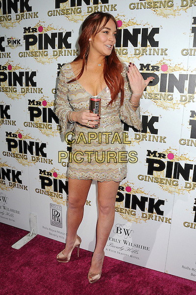 Lindsay Lohan.Mr. Pink Ginseng Drink Launch Party held at the Beverly Wilshire Hotel, Beverly Hills, California, USA..October 11th, 2012.full length dress beige gold beads beaded  peep toe shoes can  mouth open hand arm.CAP/ADM/BP.©Byron Purvis/AdMedia/Capital Pictures.