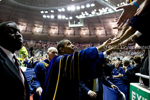 South Bend, IN - May 17, 2009 -- United States President Barack Obama shakes hands with attendees of the University of Notre Dame's 164th commencement, May 17, 2009..Mandatory Credit: Pete Souza - White House via CNP