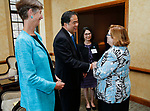 DePaul President A. Gabriel Esteban, Ph.D., and his wife Josephine are greeted by Therese Fauerbach, CEO of The Northridge Group, right, during a reception with area women leaders Thursday, July 20, 2017, at The Chicago Club. The event was organized to welcome the Estebans to Chicago and introduce them to some of Chicago's most influential women. Jay Braatz, left, vice president for planning and presidential administration, also attended the gathering. (DePaul University/Jamie Moncrief)