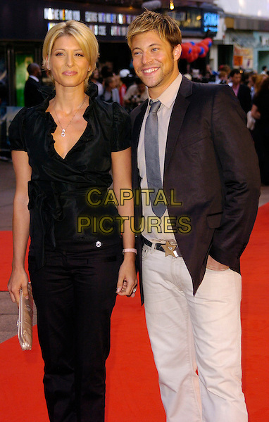 "DANI BEHR & DUNCAN JAMES.""Superman Returns"" UK film premiere, Odeon Leicester Square, London, UK..July 13th, 2006.Ref: CAN.half length black trousers top jacket white jeans denim star belt buckle.www.capitalpictures.com.sales@capitalpictures.com.©Capital Pictures"