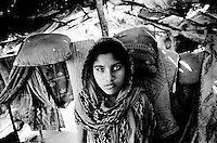 Burmese authorities have used the denial of marriage as a method to marginalize the Rohingya.  To marry, Rohingya must receive permission from the authorities and pay heavy bribes and fees, which most families can't afford.  Young couples are often arrested if they are caught getting married without permission. The denial of marriage is one of the leading causes for Rohingya youth to leave Burma, like this young girl. (2009)
