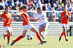 CARY, NC - NOVEMBER 19: North Carolina's Madison Schultz (1) and Princeton's Lucy Rickerson (27). The University of North Carolina Tar Heels hosted the Princeton University Tigers on November 19, 2017 at Koka Booth Stadium in Cary, NC in an NCAA Division I Women's Soccer Tournament Third Round game. Princeton won 2-1 in sudden death overtime.