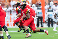 Landover, MD - September 1, 2018: Maryland Terrapins wide receiver Taivon Jacobs (12) runs the football during game between Maryland and No. 23 ranked Texas at FedEx Field in Landover, MD. The Terrapins upset the Longhorns in back to back season openers with a 34-29 win. (Photo by Phillip Peters/Media International)