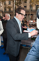 November 19 2017 PARIS FRANCE Arrival of Actor Hugh Grant at the Premiere of Paddington 2 at Olympia on Boulevard des Capucines Paris. He signs autographs.
