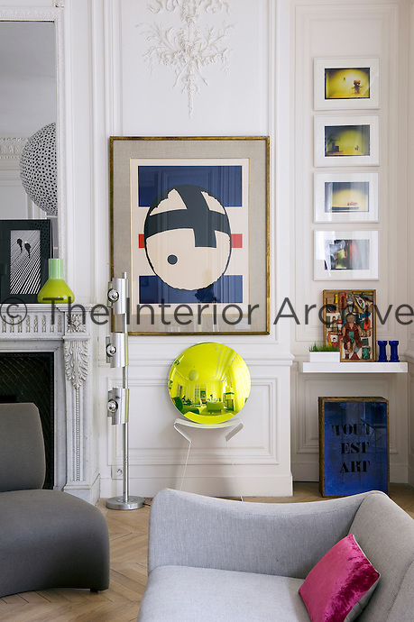 In this corner of the living room a signed print by Pierre Dimitrienko takes pride of place next to the fireplace