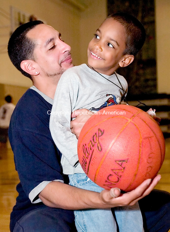 WATERBURY, CT. 15 June 2007-061507SV02--Gualberto Torres, a single father, plays basketball with his son Javon, 4 at the Greater Waterbury YMCA in Waterbury Friday. Torres tries to spend time with his kids during the day because he works the night shift when they're asleep. Torres&rsquo; mother takes care of his 3 kids during the day.<br /> Steven Valenti Republican-American
