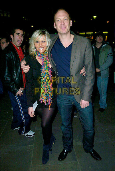"CAMILLE CUOURI & SHAUN DINGWALL.The ""Treats"" press night, Garrick Theatre, London, UK..March 8th, 2007.full length jeans denim black dress scarf colourful colorful .CAP/CAN.©Can Nguyen/Capital Pictures"