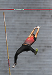 A pole vaulter clears his mark at a Cal track meet in Berkeley, CA.