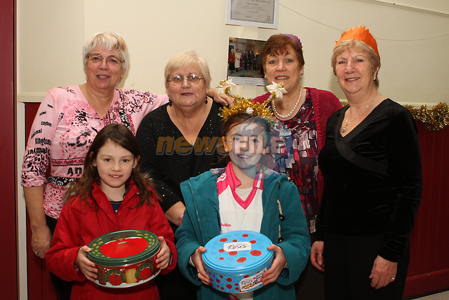Amara McGran Byrne and Emma McGrane bring in some chocolates, pictured here with Peggy Clinton, Deirdre Delaney, Claire McAuley and Marjorie Murthwaite at the Ferrard Day Care Centre Christmas Party 4/1/13..Photo NEWSFILE/Jenny Matthews..(Photo credit should read Jenny Matthews/NEWSFILE)