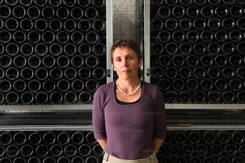 Dominique Moreau, female vigneron, with champagne bottles, at her domaine brand 'Marie-Courtin'. at Polisot, Champagne Ardennes...A new generation of vignerons around Troyes, city of the Aube, the forgotten region of Champagne, France. These new, but not necessarily young, producers, make Champagnes that are in many ways anti-Champagnes. Where Champagne for a century has made a myth of the art of blending, in which the usual distinctions of terroir, grape and vintage disappear into the house blend, these producers take a Burgundian approach to making Champagne, emphasizing all these qualities that are taken for granted as important in other regions but are largely ignored in Champagne. In a sense they each are a microcosm for larger changes taking place throughout the Champagne region, not just in the Cote des Bars, and for changing perceptions of Champagne on the part of American consumers