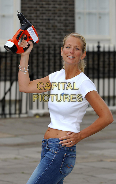 ULRIKA JONSSON.launches launch of Telewest free digital TV and phone deal..sales@capitalpictures.com.www.capitalpictures.com.©Capital Pictures.drill, midriff.half length, half-length