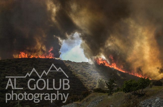 August 18, 2001 Coulterville, California  -- Creek Fire –  The active fire and the backfire come together on Alan Haigh Ranch.  The Creek Fire burned 11,500 acres between Highway 49 and Priest-Coulterville Road a few miles north of Coulterville, California.