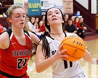 Westside Eagle Observer/RANDY MOLL<br /> Gentry's Ahrya Reding looks to shoot under the basket during play against Farmington High School at Gentry on Jan. 14, 2020.