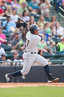 Jackson Valera (27) of the Charleston RiverDogs follows through on his swing against the Hickory Crawdads at L.P. Frans Stadium on May 25, 2014 in Hickory, North Carolina.  The RiverDogs defeated the Crawdads 17-10.  (Brian Westerholt/Four Seam Images)