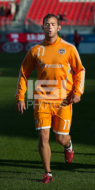 07 May 2011: Houston Dynamo midfielder Brad Davis #11 warms up during an MLS game between the Houston Dynamo and the Toronto FC at BMO Field in Toronto, Ontario..Toronto FC won 2-1.