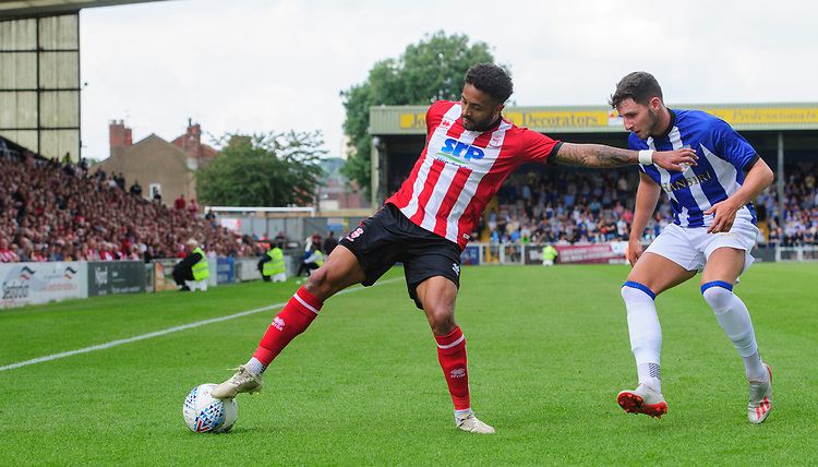 Lincoln City's Bruno Andrade shields the ball from Sheffield Wednesday's Matt Penney<br /> <br /> Photographer Chris Vaughan/CameraSport<br /> <br /> Football Pre-Season Friendly - Lincoln City v Sheffield Wednesday - Saturday July 13th 2019 - Sincil Bank - Lincoln<br /> <br /> World Copyright © 2019 CameraSport. All rights reserved. 43 Linden Ave. Countesthorpe. Leicester. England. LE8 5PG - Tel: +44 (0) 116 277 4147 - admin@camerasport.com - www.camerasport.com