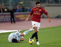Calcio, Serie A: Roma vs Lazio. Roma, stadio Olimpico, 16 novembre 2008. .Football, Italian serie A: Roma vs Lazio. Rome, Olympic stadium, 16 november 2008..AS Roma forward Mirko Vucinic, of Montenegro, in action past Lazio defender Stefan Radu, of Romania, left..UPDATE IMAGES PRESS/Riccardo De Luca