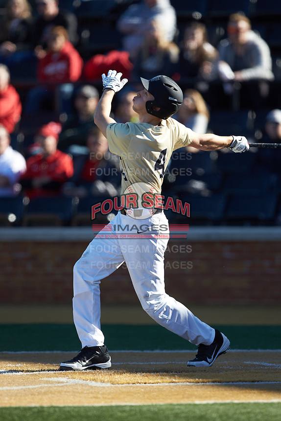 D.J. Poteet (4) of the Wake Forest Demon Deacons follows through on his swing against the Gardner-Webb Runnin' Bulldogs at David F. Couch Ballpark on February 18, 2018 in  Winston-Salem, North Carolina. The Demon Deacons defeated the Runnin' Bulldogs 8-4 in game one of a double-header.  (Brian Westerholt/Four Seam Images)