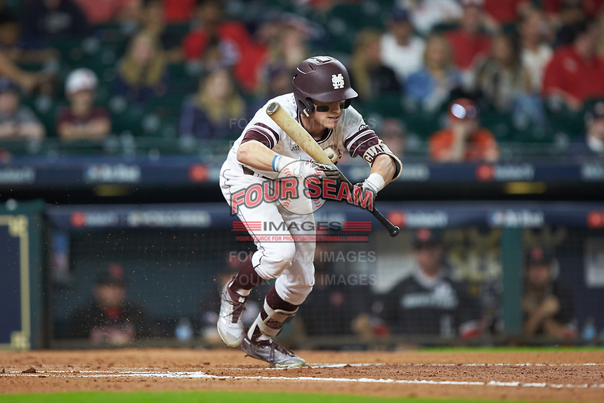 Jake Mangum (15) of the Mississippi State Bulldogs is hit in the chest by the baseball after laying down a bunt against the Houston Cougars in game six of the 2018 Shriners Hospitals for Children College Classic at Minute Maid Park on March 3, 2018 in Houston, Texas. The Bulldogs defeated the Cougars 3-2 in 12 innings. (Brian Westerholt/Four Seam Images)