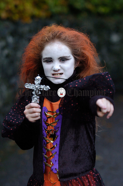 Corinna Fox of Shannon scares away the vampires during the Halloween Festivities at Bunratty Folk Park. Photograph by John Kelly.