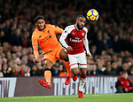 Arsenal's Alexandre Lacazette tussles with Liverpool's Joe Gomez during the premier league match at the Emirates Stadium, London. Picture date 22nd December 2017. Picture credit should read: David Klein/Sportimage