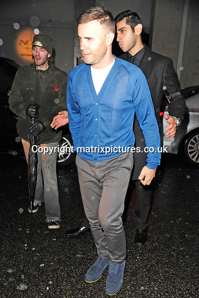 NON EXCLUSIVE PICTURE: MATRIXPICTURES.CO.UK<br /> PLEASE CREDIT ALL USES<br /> <br /> WORLD RIGHTS<br /> <br /> English singer-songwriter Gary Barlow OBE is pictured as he leaves Nobu Berkeley St, in London.<br /> <br /> The X Factor judges hired out the venue exclusively until 4am, after appearing on the show. It has been said that Nicole Scherzinger paid the entire bill.<br /> <br /> NOVEMBER 3rd 2013<br /> <br /> REF: ASI 137144