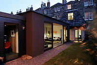 A view at night into the interior of a home that brings piece of Scandinavian Modernism to the heart of West Edinburgh. The owners took an opportunity to combine design ideas taken from rural Danish coastal dwellings and an urban British-Victorian aesthetic with the latest in eco technology.  The modern extension to the house, juxtaposed with the surrounding period properties, definitely holds its own.