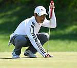 Parkway South HS golfer Jay-R Charoenrit positions the ball before his putt. The District 3 Boys Golf Championships were held at The Quarry at Crystal Springs Golf Course on Monday April 30, 2018. Tim Vizer | Special to STLhighschoolsports.com