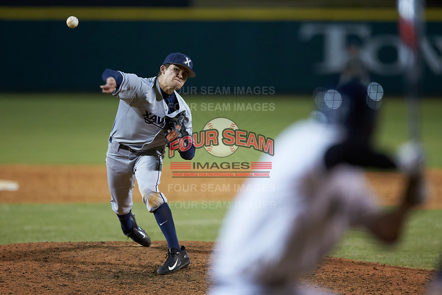 Xavier Musketeers relief pitcher Conor Grammes (4) in action against the Penn State Nittany Lions at Coleman Field at the USA Baseball National Training Center on February 25, 2017 in Cary, North Carolina. The Musketeers defeated the Nittany Lions 7-5 in game two of a double header. (Brian Westerholt/Four Seam Images)