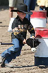 Jackie Sceirine competes in the Pee-Wee Stick Horse Barrel Race at the Fallon Junior Rodeo.  Photo by Tom Smedes.