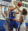 Jessie Brower #22 of Kellenberg, center, drives to the net during a CHSAA varsity girls basketball game against host Our Lady of Mercy Academy on Friday, Jan. 13, 2017. Kellenberg won by a score of 48-47.
