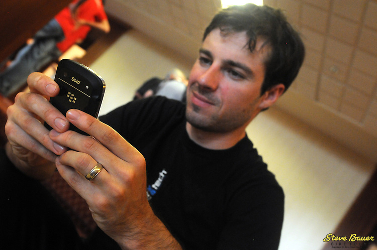 Zach Bell keeps in touch with his BlackBerry the day before the  UCI 2.2 Tour de Beauce. June 11, 2012. Photo by Brian Hodes/VeloImages