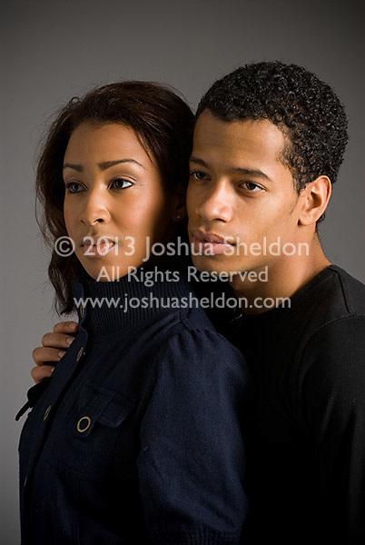 Studio portrait of young Hispanic couple