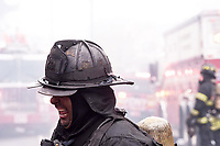 Firefighter Quinn of Rescue Company 2 after operating at a two alarm fire on Avenue I in the Flatlands section of Brooklyn on Friday,May,5th.