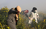 Palestinian protesters clash with Israeli troops following the tents protest where Palestinians demand the right to return to their homeland at the Israel-Gaza border, in Khan Younis in the southern Gaza Strip, March 08, 2019. A Palestinian youth was killed by Israeli fire as he protested on the frontier of the Gaza Strip and Israel on Friday, and at least 41 other were wounded according to Gaza's health ministry. Photo by Ashraf Amra