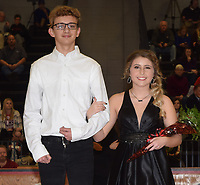 RICK PECK/SPECIAL TO MCDONALD COUNTY PRESS<br /> Junior queen attendant Taylor Tyson is escorted by junior king attendant Garrett Spears