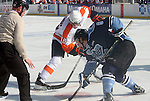 OMAHA, NE - FEBRUARY 9:  Robbie Baillargeon #18 from the Omaha Lancers and Tommy Schutt #8 from the Lincoln Stars battle for the puck on a face off in the first period at the Battle on Ice Saturday at TD Ameritrade in Omaha, NE. (Photo by Schyler Eggen/Inertia)