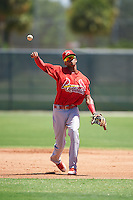 GCL Cardinals shortstop Delvin Perez (23) warmup throw to first during the second game of a doubleheader against the GCL Marlins on August 13, 2016 at Roger Dean Complex in Jupiter, Florida.  GCL Cardinals defeated GCL Marlins 2-0.  (Mike Janes/Four Seam Images)