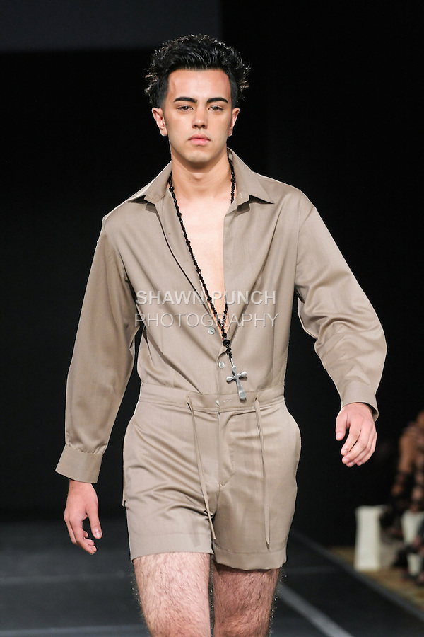 Model walks the runway in an outfit by Edwing D'Angelo, for his Edwing D'Angelo Spring 2011 fashion show, during Couture Fashion Week, September 12, 2010.