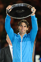 MELBOURNE, 30 JANUARY - Rafael Nadal (ESP) accepts the runner's up trophy at the men's finals match on day 14 of the 2012 Australian Open at Melbourne Park, Australia. (Photo Sydney Low / syd-low.com)